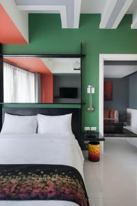 A bed or beds in a room at KL Serviced Residences Managed by HII