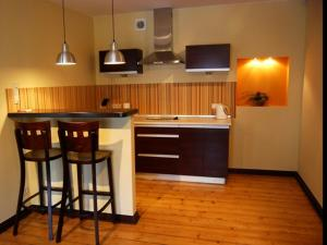 A kitchen or kitchenette at Home & Travel