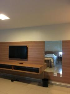 A television and/or entertainment centre at Vgfun Beach condominio