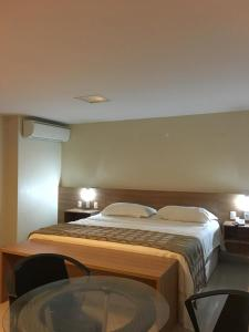 A bed or beds in a room at Vgfun Beach condominio