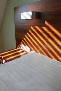 מיטה או מיטות בחדר ב-Sky Apartments Vienna