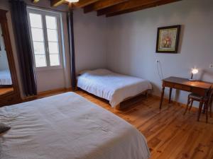 Un ou plusieurs lits dans un hébergement de l'établissement Spacious holiday home in Castelmoron-sur-Lot with Garden