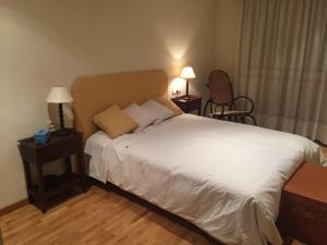 A bed or beds in a room at CENTRO CIUDAD-PZA AYUNTAMIENTO-WIFI