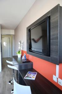 A television and/or entertainment center at Adonis Paris Sud