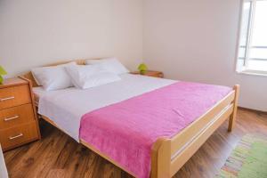 Postel nebo postele na pokoji v ubytování Apartments Zivkovic