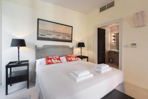 A bed or beds in a room at Bastina Apartments Dubrovnik I