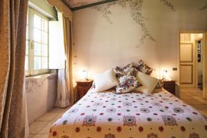מיטה או מיטות בחדר ב-Cottage del Limone