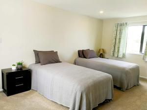 Кровать или кровати в номере Stunning Stay In Auckland