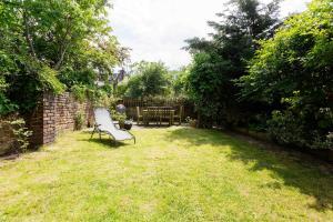 A garden outside Veeve - Timeless Family Home