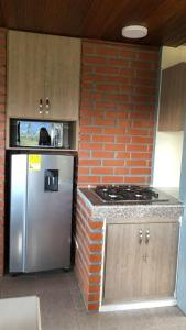 A kitchen or kitchenette at Chalet la Bonita