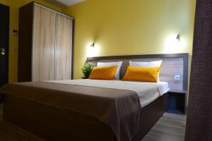 מיטה או מיטות בחדר ב-Visito Aparthouse