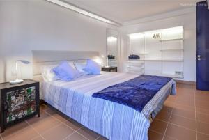 Säng eller sängar i ett rum på Residence Ocean View - Vespa 50