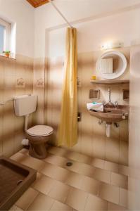 A bathroom at MARE BLU STUDIOS & SUITES