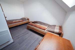 Postel nebo postele na pokoji v ubytování ubytování U Římských