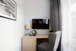 A television and/or entertainment centre at Monte Carlo Apartments