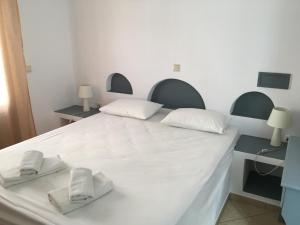 Кровать или кровати в номере Camares
