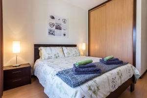 Cama ou camas em um quarto em Casa de Casa
