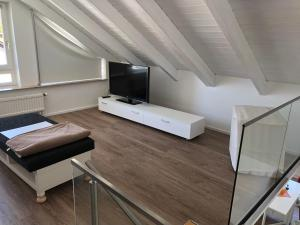 A television and/or entertainment center at Maisonette Alpenblick