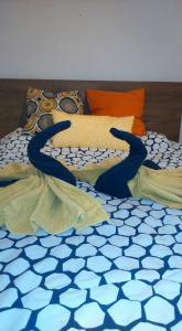 A bed or beds in a room at Epres Flat