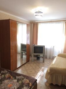 Телевизор и/или развлекательный центр в Апартаменты на 139 стрелковой 8