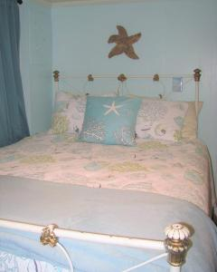 A bed or beds in a room at Enchanted Cottages