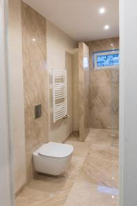Kúpeľňa v ubytovaní Rooftop apartment II.