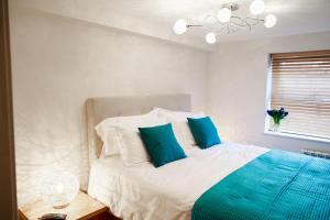 A bed or beds in a room at Fishergate Apartments