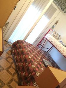 Кровать или кровати в номере Casa Vacanza