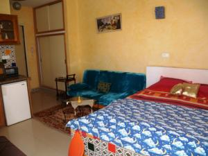 A bed or beds in a room at Dar El Amen Appartements