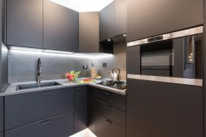 Een keuken of kitchenette bij La Gabbia del Grillo