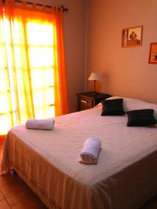A bed or beds in a room at Naipi Apart