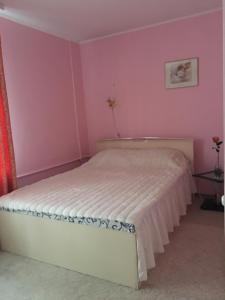 Katil atau katil-katil dalam bilik di Appartamenty 2