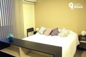 Una cama o camas en una habitación de Alquileres Temporarios Rafaela