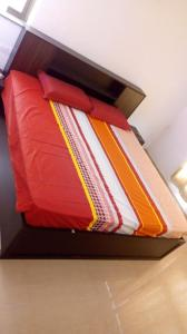 A bed or beds in a room at Vishal sarovar lake view