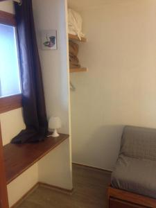 A bed or beds in a room at Résidence le hameau du borsat