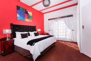 Lova arba lovos apgyvendinimo įstaigoje Best Western Cape Suites Hotel