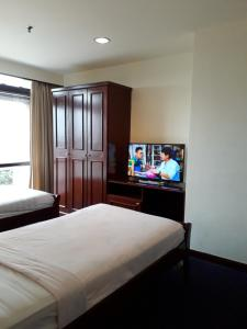 A bed or beds in a room at Kl Better apartment @ timesquare
