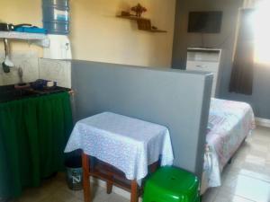 Uma área de estar em Alto Paraíso Flats