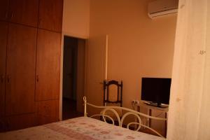 Ένα ή περισσότερα κρεβάτια σε δωμάτιο στο Sofias Home