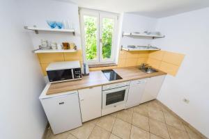 Kuhinja ili čajna kuhinja u objektu Apartman Tonko