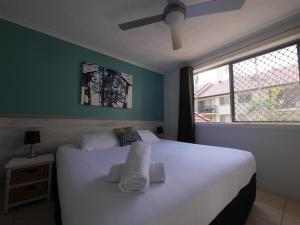 A bed or beds in a room at K Resort Surfers Paradise Apartments