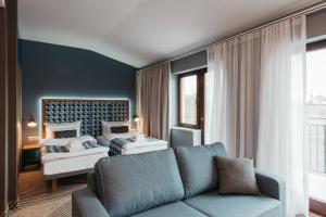 A bed or beds in a room at Avena by Artery Hotels