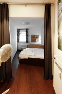 Ein Bett oder Betten in einem Zimmer der Unterkunft City Apartments Gladenbach