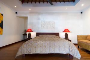 Vuode tai vuoteita majoituspaikassa Ellora Villa