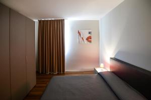 A bed or beds in a room at Residence Nazionale Matera