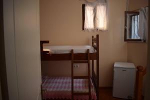 Μία ή περισσότερες κουκέτες σε δωμάτιο στο Sofias Home