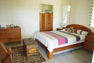 A bed or beds in a room at Samoan Highland Hideaway