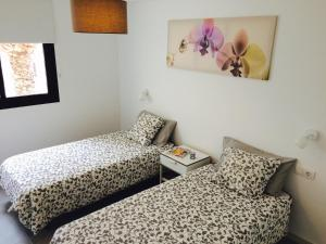 A bed or beds in a room at Apartment Carmen Sunrise, Los Cristianos