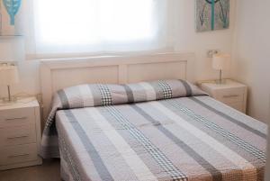 Cama o camas de una habitación en Apartamentos Veneziola Golf II