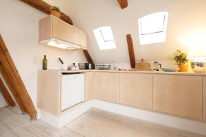 A kitchen or kitchenette at Central Canal Apartments
